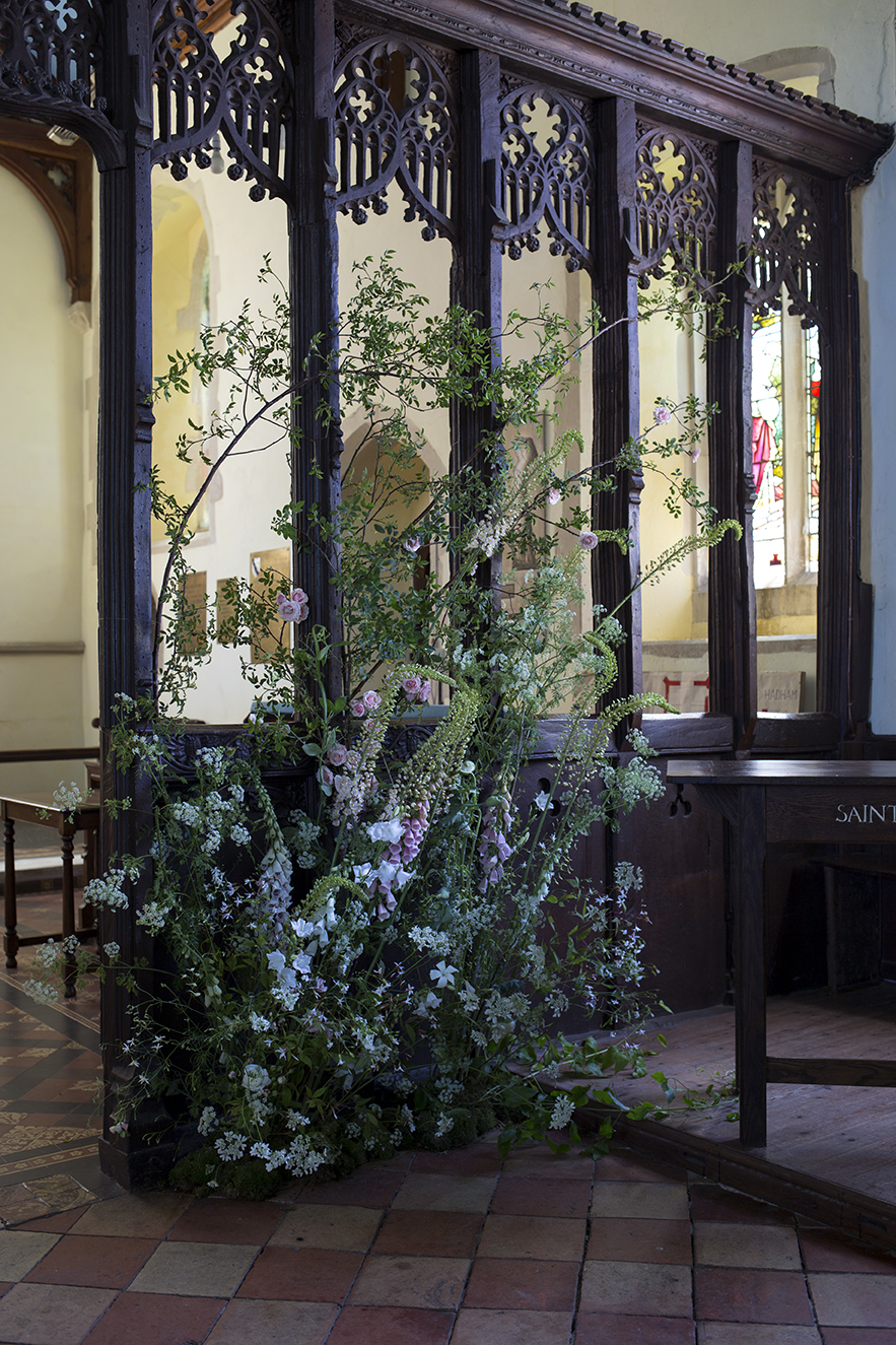 The beautiful wooden screen in this ancient, storied church provided the frame for a 'growing up from the ground' installation and included crisp ice-white campanula and wispy gillenia to 'pop' against the dark backdrop
