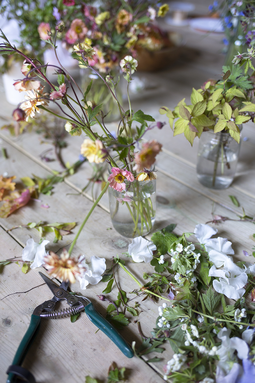 Flowers and secateurs on the workbench at Aesme Flower Studio