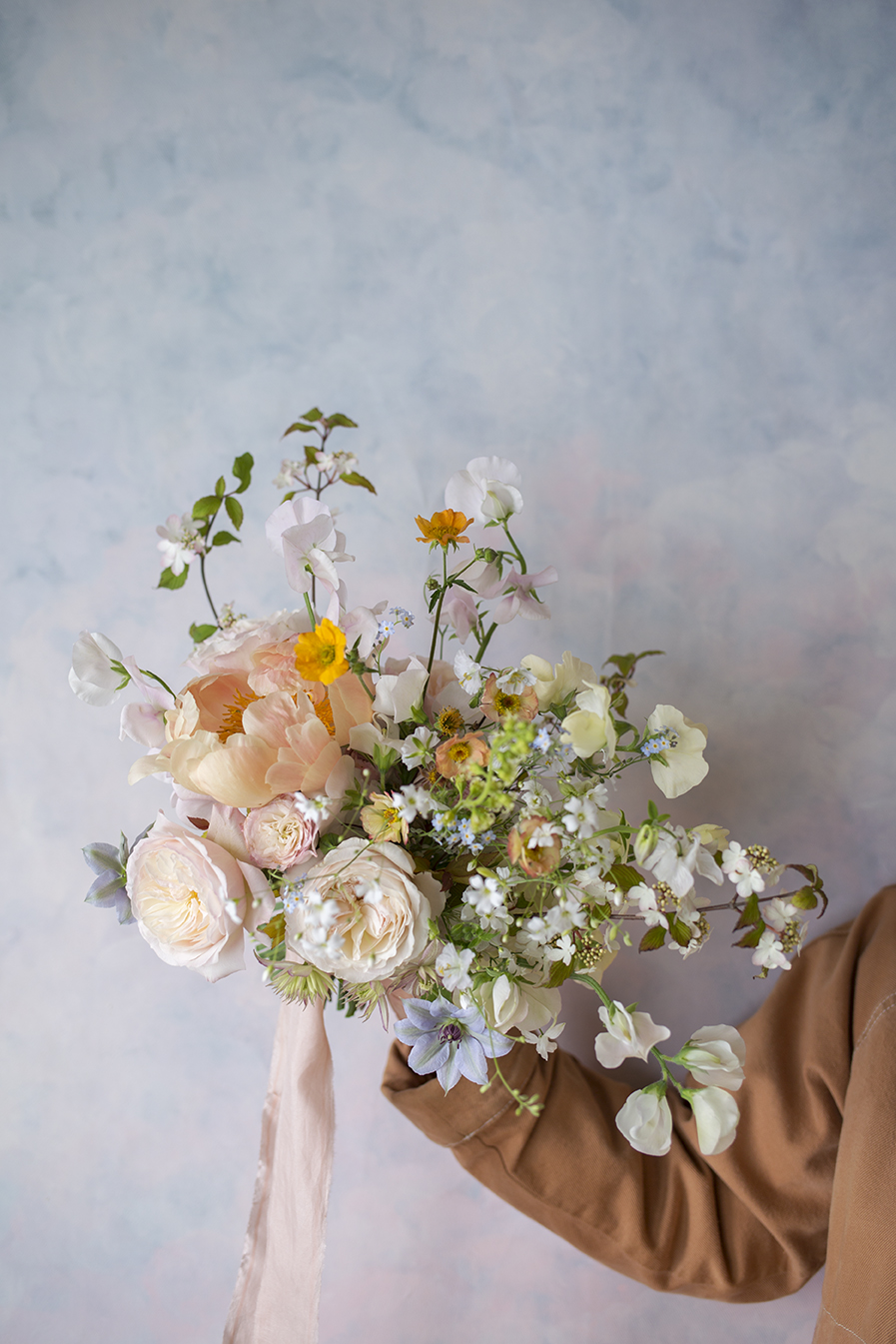 Spring wedding bouquet with coral charm peony and geum flowers by Aesme Flower Studio