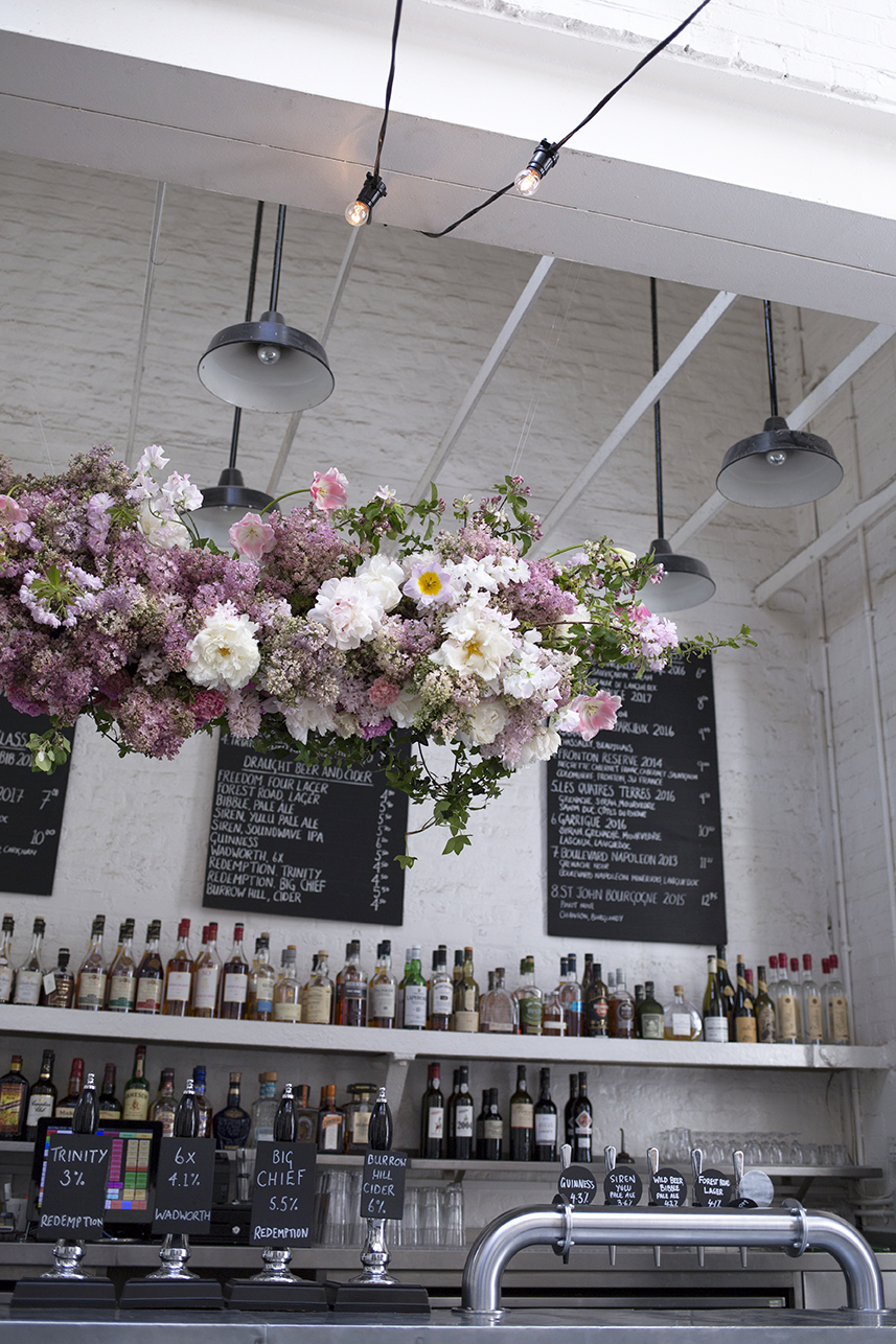 A suspended 'flower cloud' installation of lilac, cherry blossom, tulips and ice-cream coloured peonies was hung over the bar at  St John, Smithfield  to decorate the afternoon cocktails