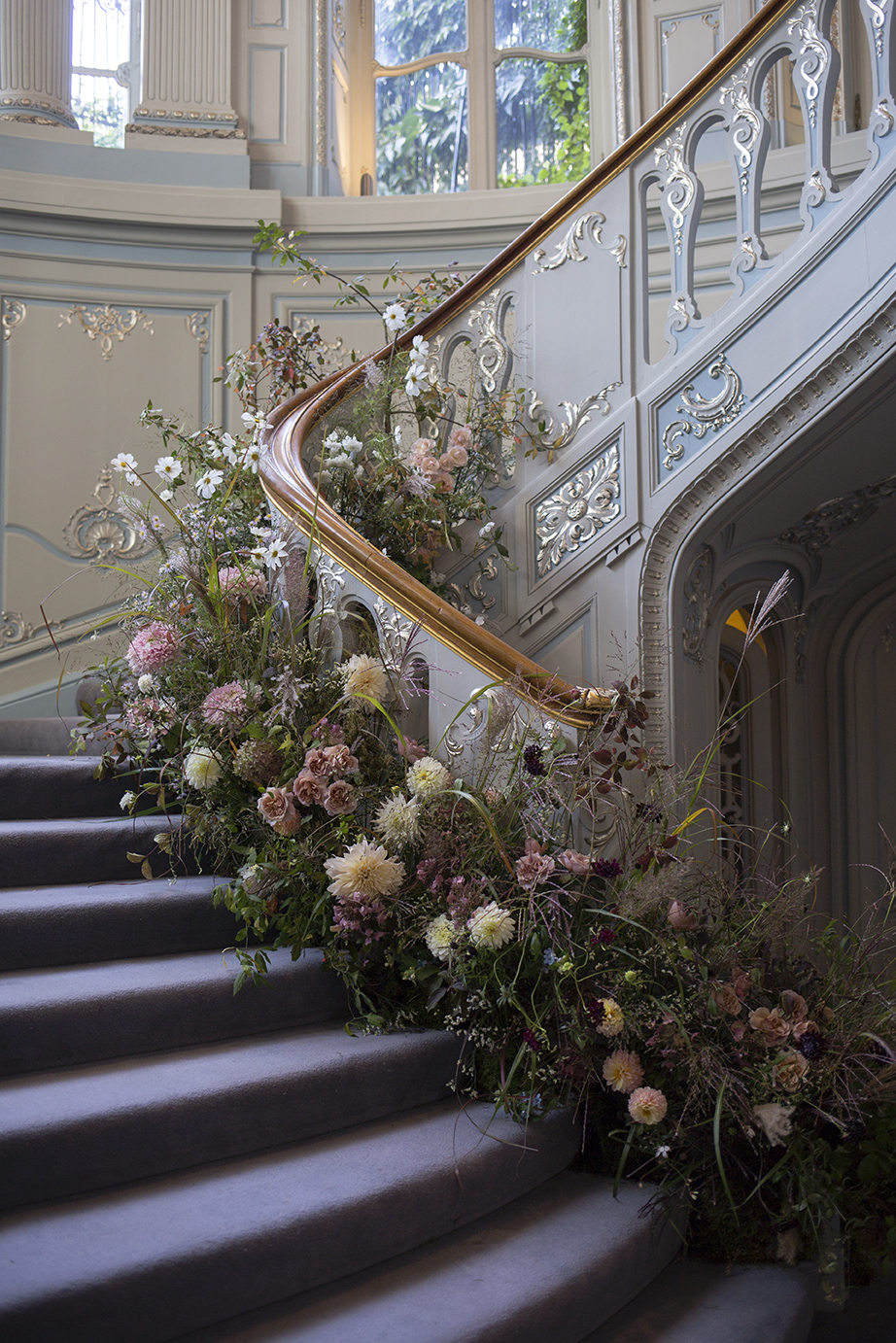 An autumnal floral staircase design at The Savile Club in Mayfair London by Aesme Flower Studio
