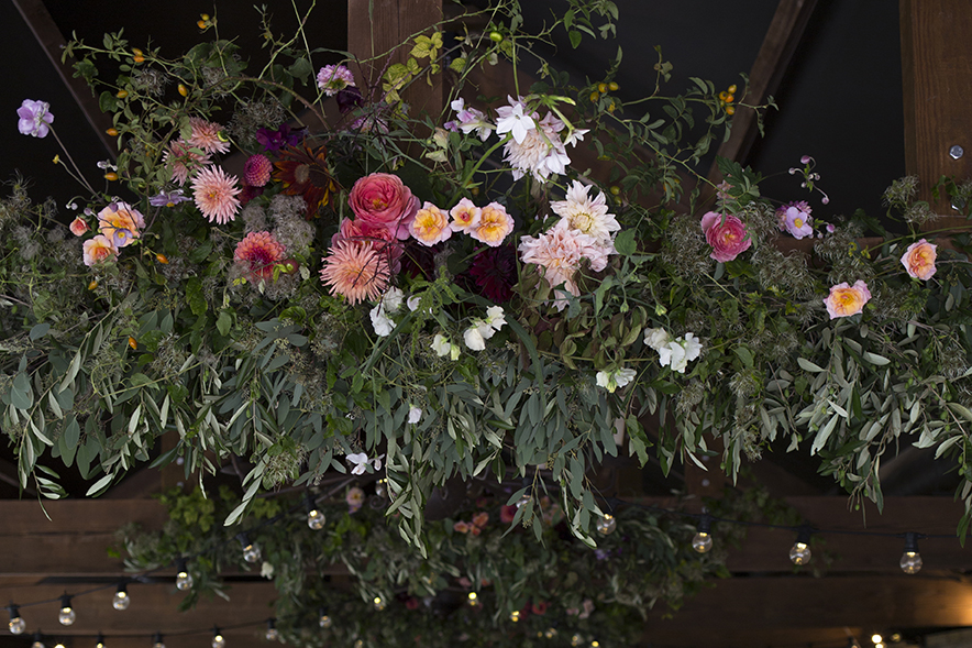 In the barn we hung garlands of foliage, dahlias, roses, Japanese anemones and wild clematis vines from the beams, highlighted with lime-y bramble leaves and orange rosehips