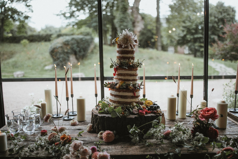The dessert table was dressed with dahlias, clematis vine and autumnal fruits. Photographed by  James Frost