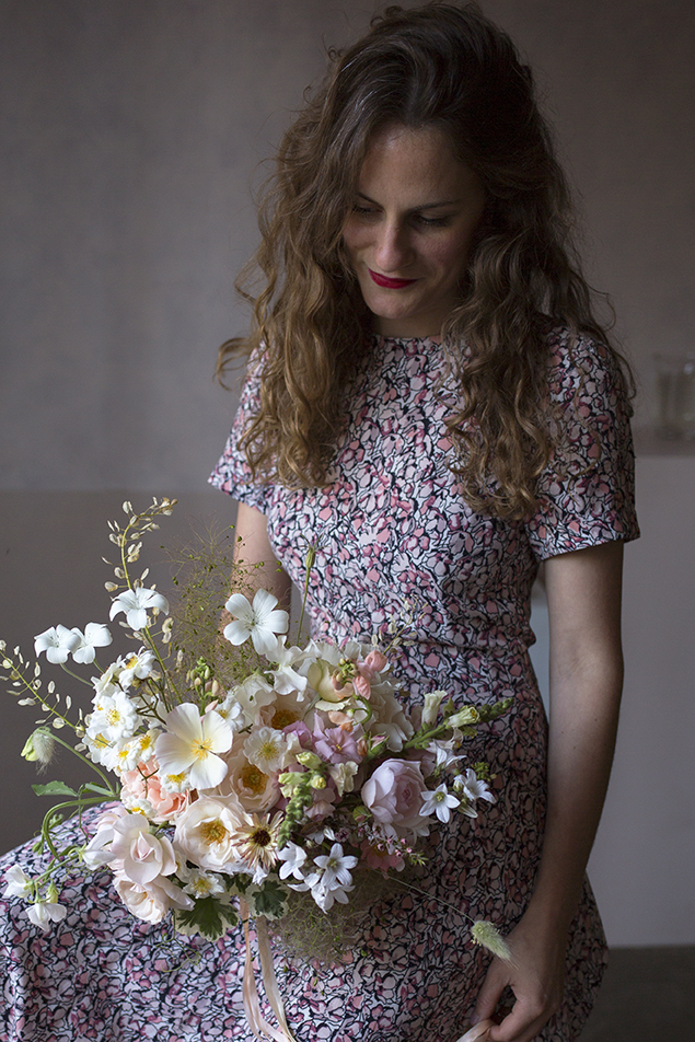 A summer bridal bouquet in a palette of white, peach and primrose yellow with dried field pennycress