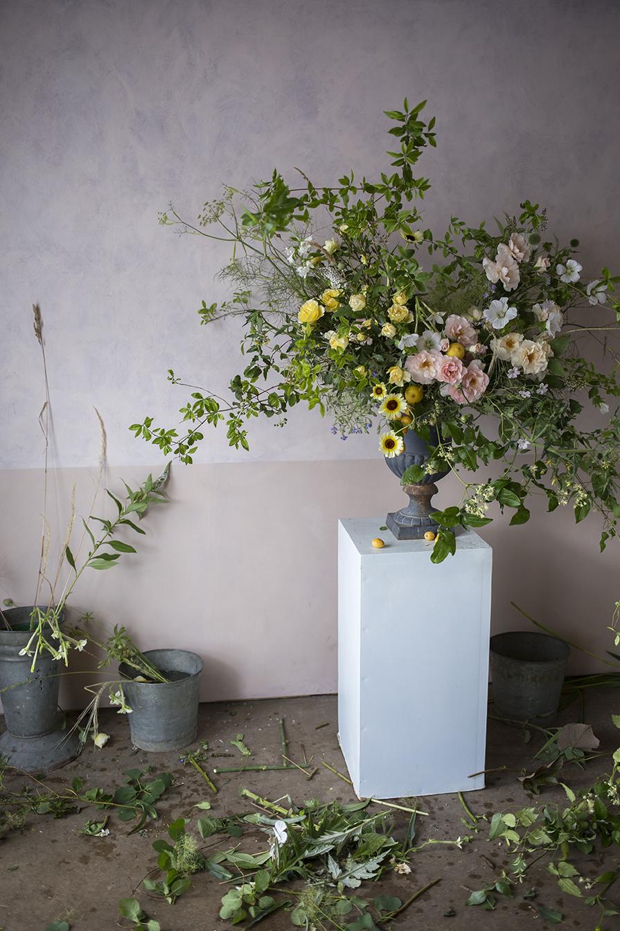 A large floral urn demonstration using garden roses and lemons at a group workshop at Aesme Flower Studio