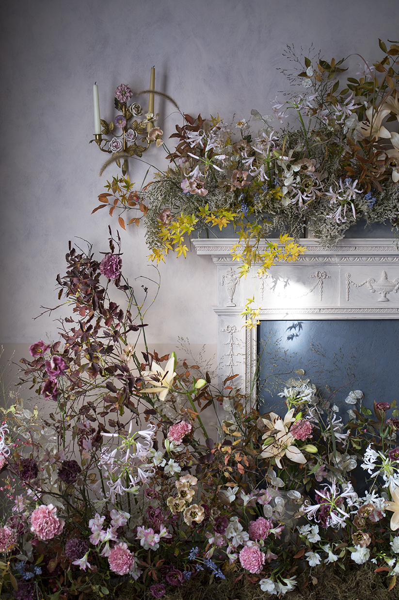 A mantelpiece installation of autumnal flowers and foliage made during a group workshop at Aesme Flower Studio