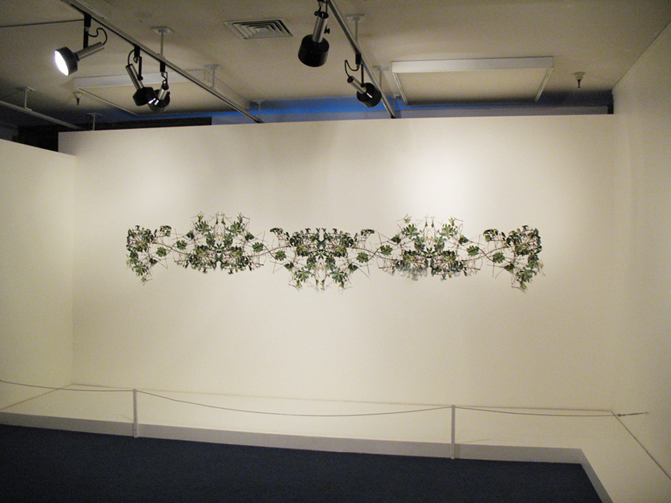 "Frieze III,  hand-cut c-prints, collage, 32"" x 160"", 2006."