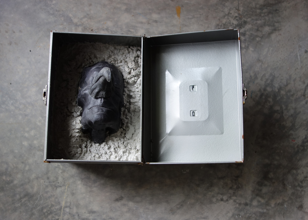 RETURN TO SENDER II, 2015, cast cultured granite, cement and metal box