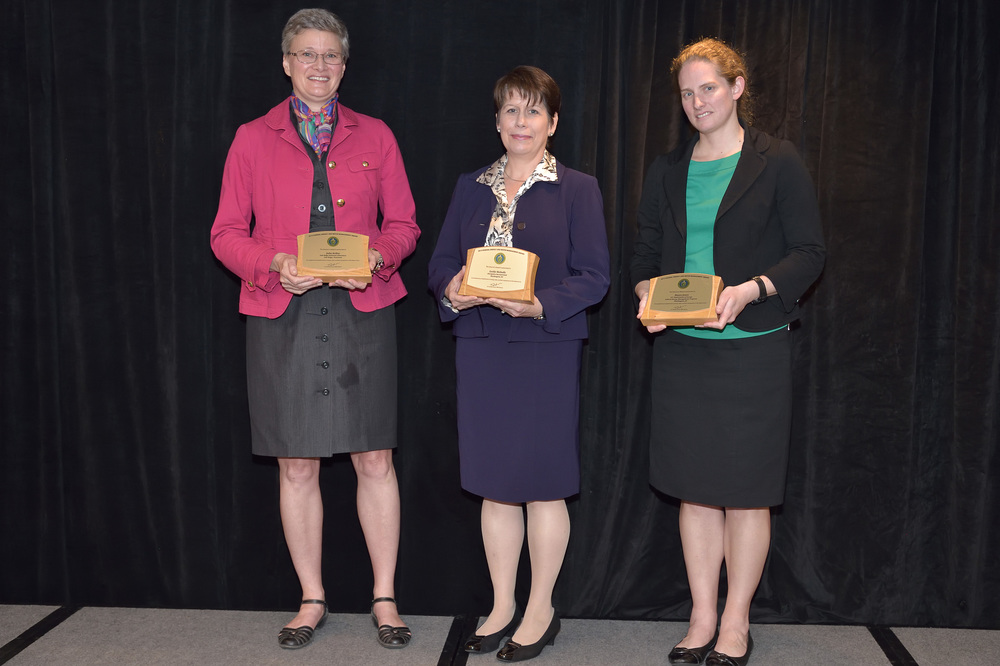 Energetics Vice President Leslie Nicholls (center) received a Director's Award during FEMP's 2015 Federal Energy and Water Management Awards ceremony on October 14, 2015. Photo Credit: Charles Watkins, U.S. Department of Energy.
