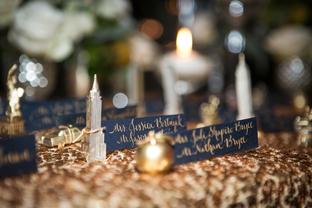 gold-sequin-tablecloth-nyc-escort-card-figurine