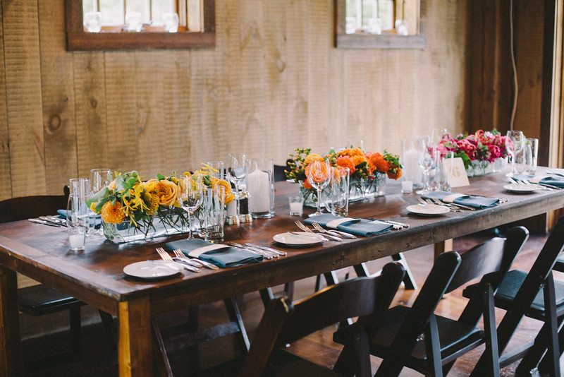 ombre-magenta-orange-yellow-wedding-centerpiece-barn-farm-tables
