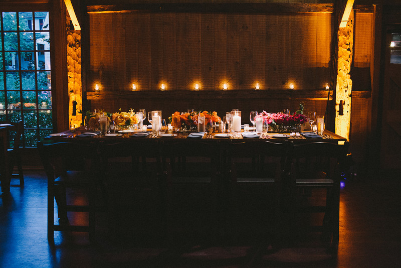 barn-wedding-rustic-chic-farm-tables-uplighting-amber