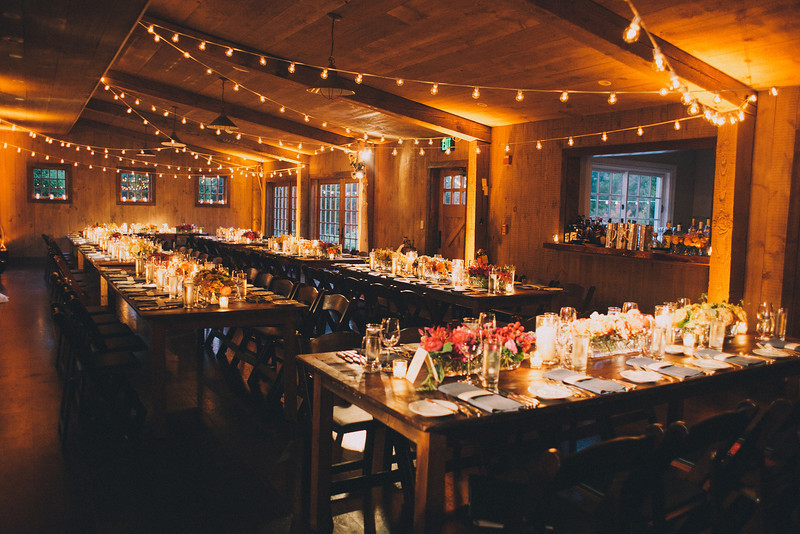 barn-wedding-string-lights-rustic-chic-farm-tables-uplighting-amber