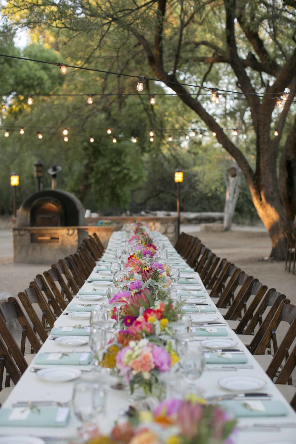 long-tables-wedding-desert-string-lights-peach-chic