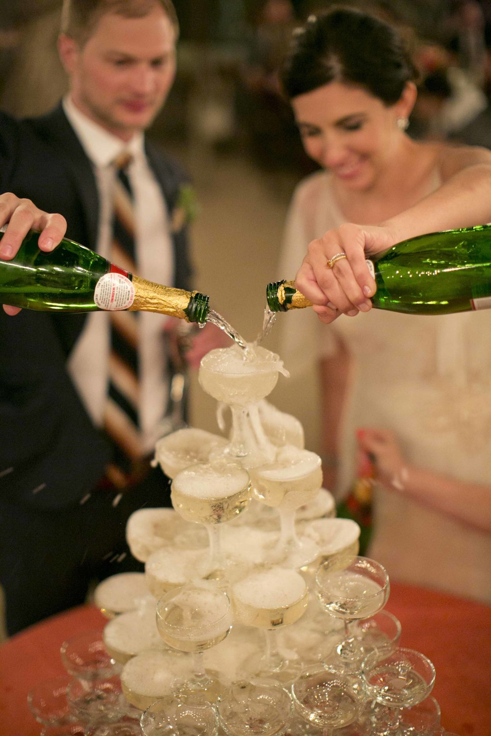 champagne-coup-glass-wedding-tower-pour