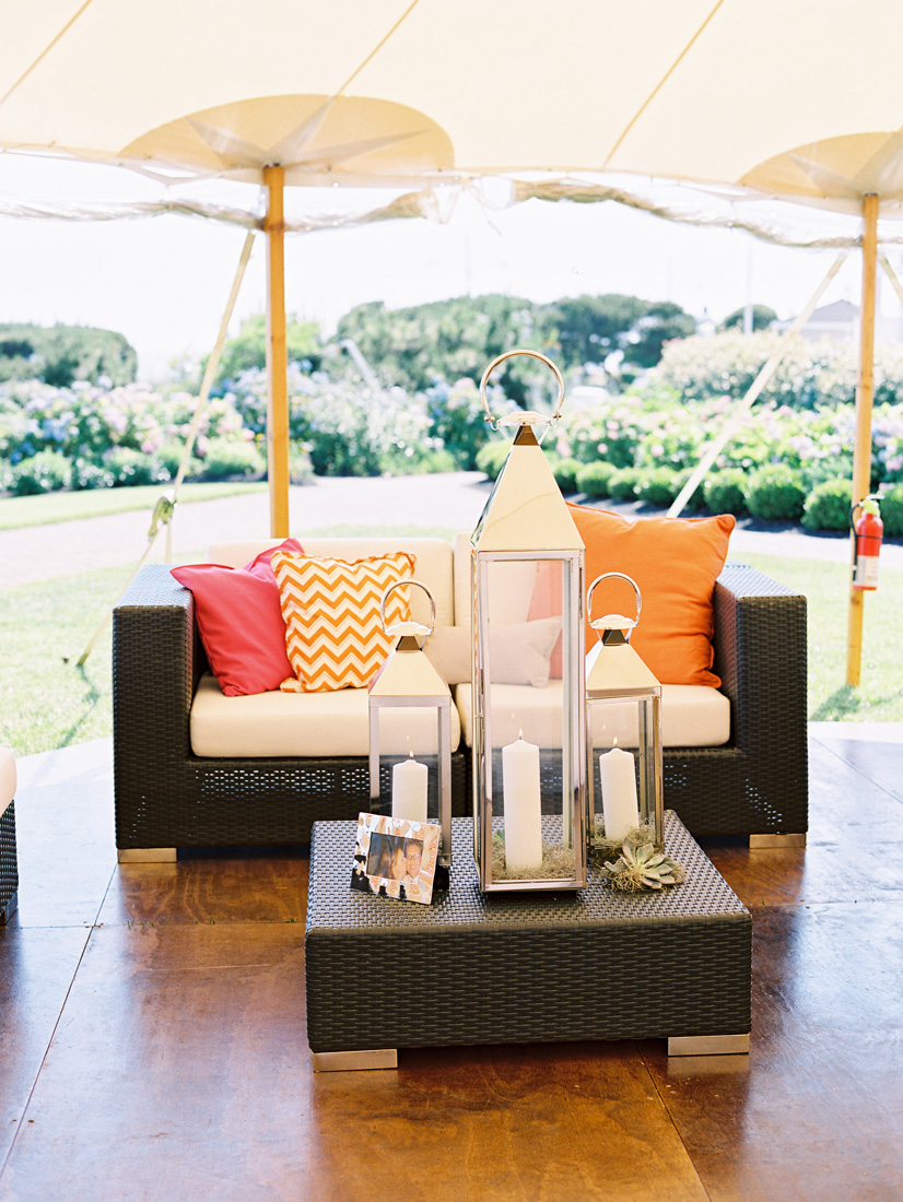 chic-beach-lounge-dark-rattan-white-silver-lantern-orange-pink