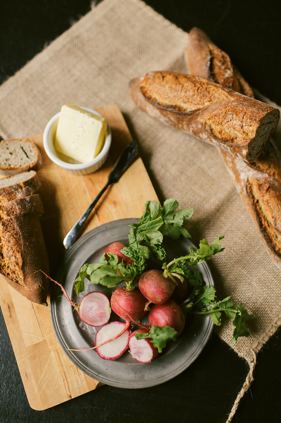 radish-rustic-baguette-cutting-board-burlap-food-styling