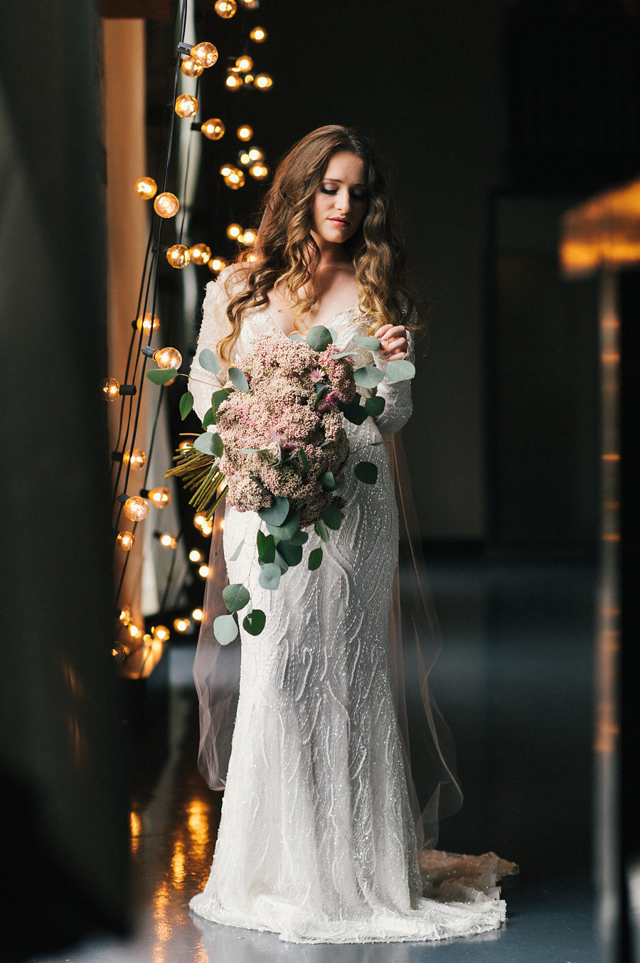 the-green-building-bride-string-lights-long-sleeve-dress-unique-bouquet