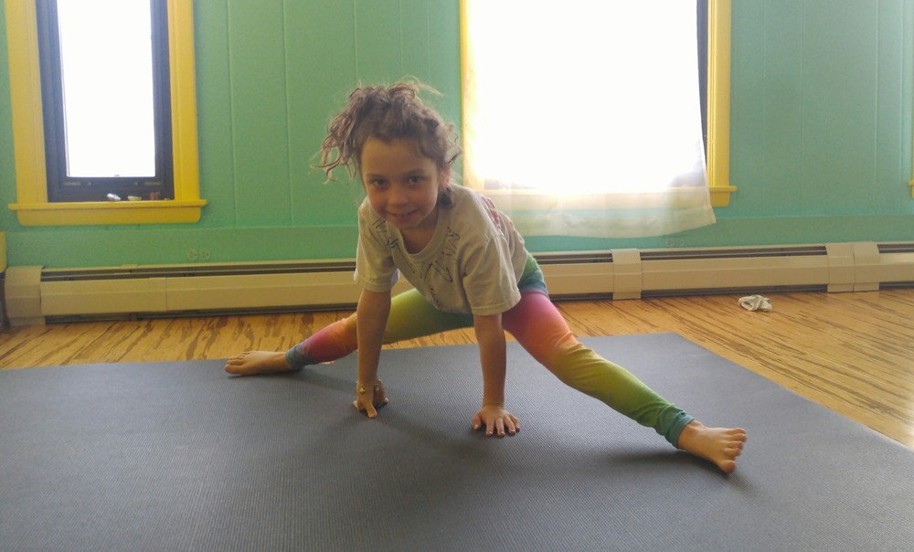 Hunter: age 8, Favorite postures: Headstand, Chakrasana (even though I can't do it yet)