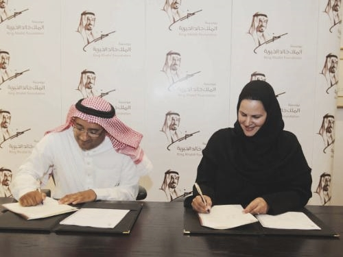 Princess Banderi Bint Abdulrahman Al Faisal, Director General of the King Khalid Foundation, and  Mohamed Al Ayed, TRACCS CEO, sign the strategic partnership agreement in Riyadh