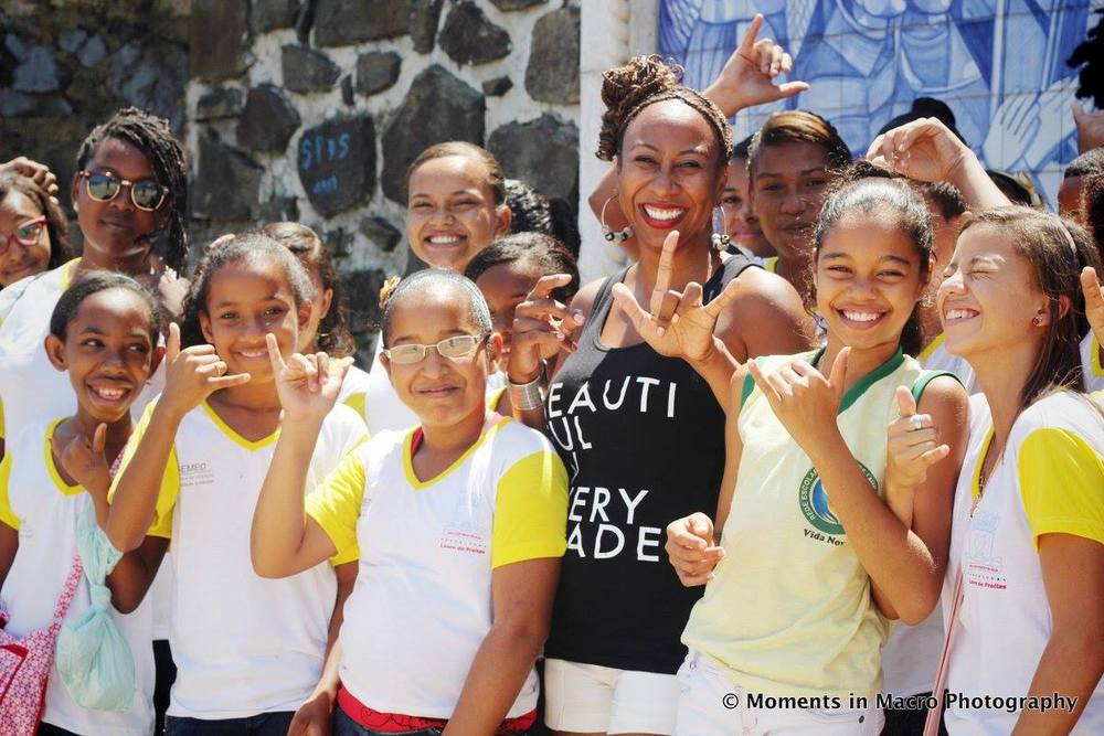 Dara Braddock with Brazilian school children are BEAUTIFUL IN EVERY SHADE.  Photo by Melissa Creary