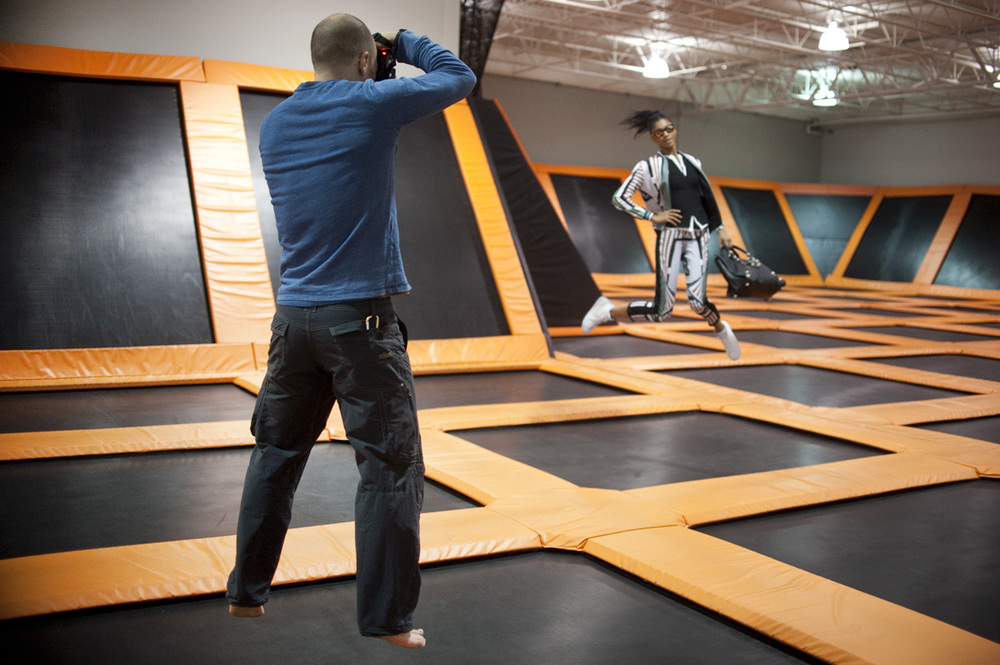 Christian bouncing in time with the model as he shoots. 2014