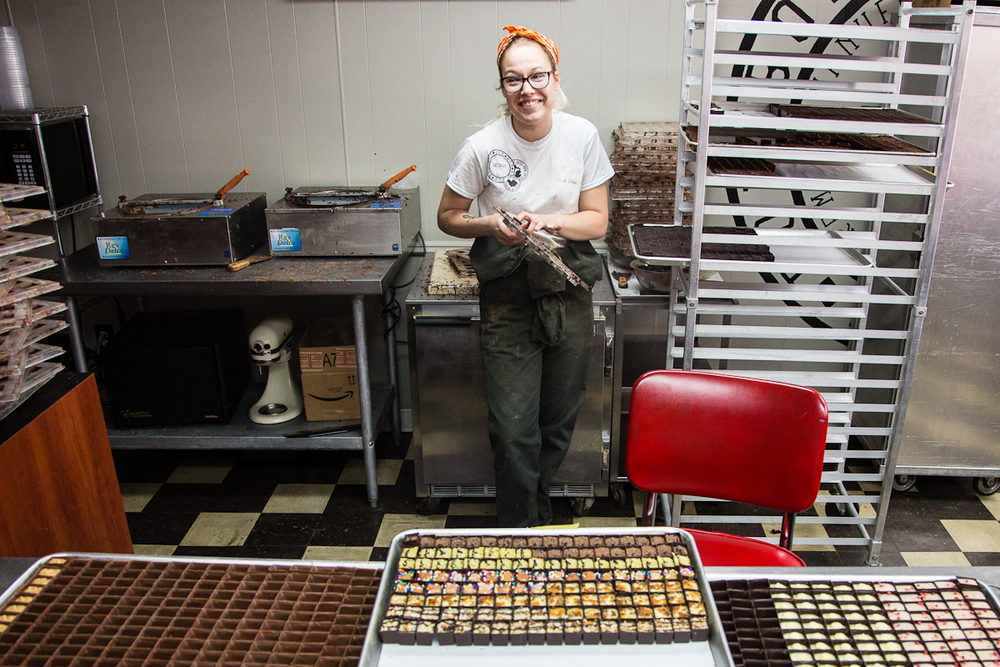 Bon Bon Bon Production Managment Assistant Margie Spakoff, 19, cleans chocolate off of molding trays Wednesday, June 3 in their Hamtramck location, 2756 Evaline St.