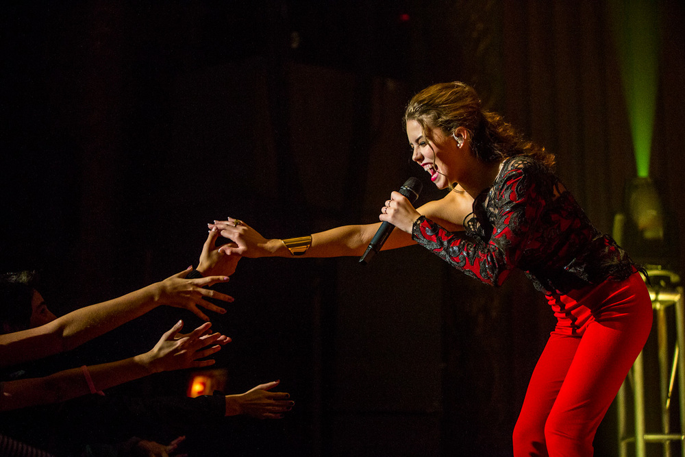 SOFI K reaching out to fans during her first concert at the Royal Oak Music Theatre.