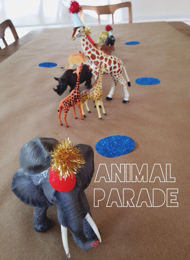 Animal party hats with pom-poms