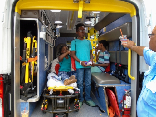 Some of our Young Residents from  Casa Otoña l in New Haven, Connecticut getting a tour of an ambulance from the New Haven Fire Department