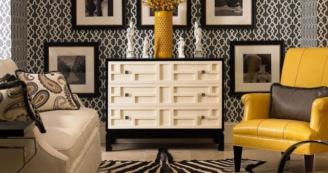 Bright yellow leather chair and vase make  this black and white room pop. Century Furniture