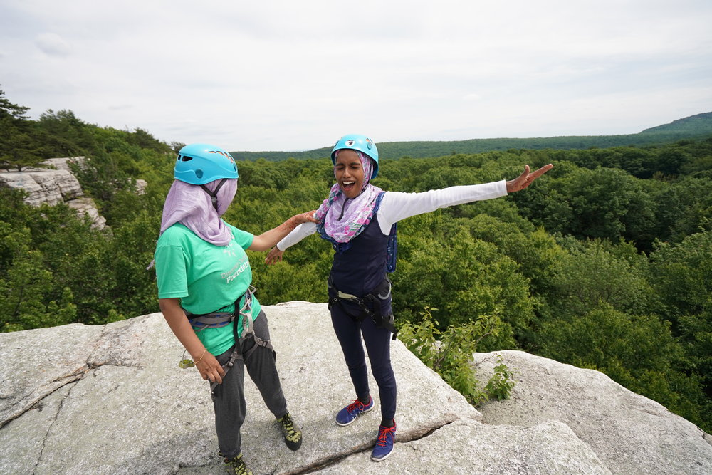 Tahmina and Marjana reveling in their ascent of the cliff! The Gunks, NY  Photo by Chris Vultaggio