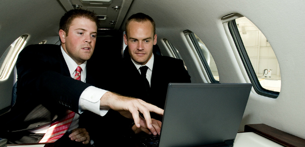 Business professional working on Chicago Aircraft Charter and Chicago Jet