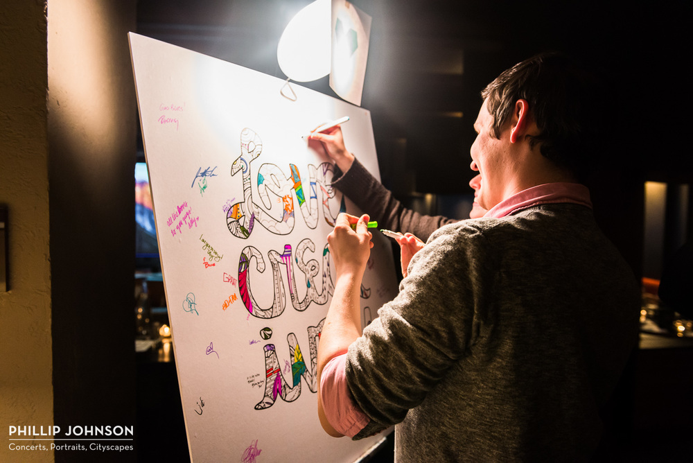 """Love Creatively"" poster, signed and colored by attendees"