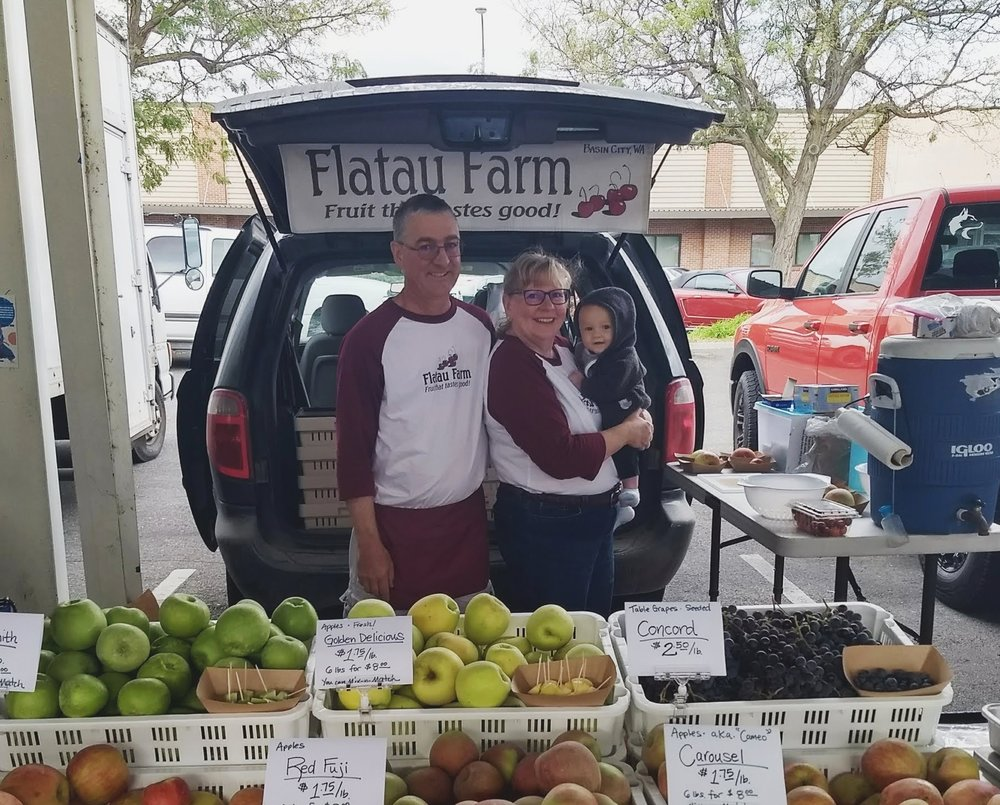 Paul and Sue with Grandson Zane at the Pasco Farmers Market