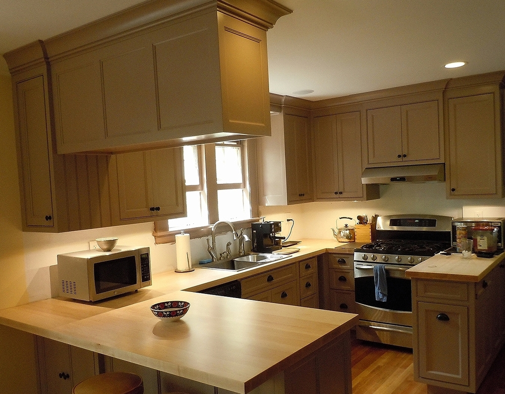Custom designed kitchen with beaded inset cabinets