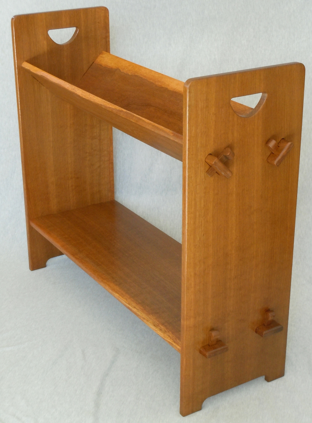 Arts and Crafts style pierced bookshelf