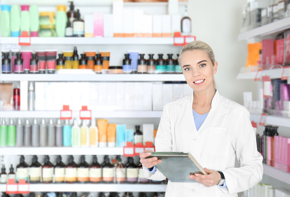 Esthetician in front of product shelf