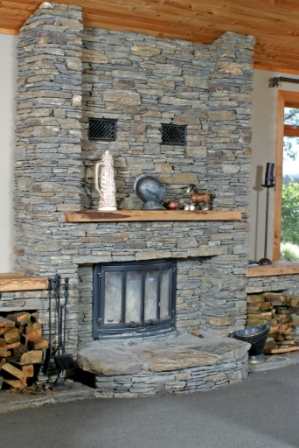 Custom Schist wood fire & sourrounds