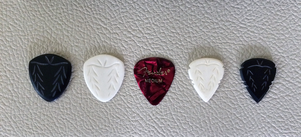 Iron Age picks compared to a Fender Medium. JazzRT on the left, Spearhead on the right.