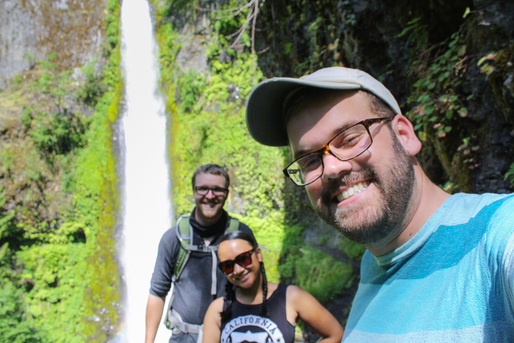 A groupie in front of the falls.