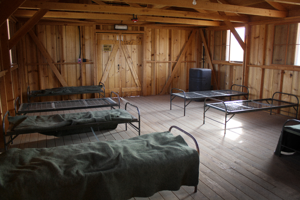 """Inside the barracks, I couldn't help but get the feeling I did when walking around Dachau Concentration Camp outside of Munich, Germany. I get a strange feeling when I'm """"touring"""" these locations."""