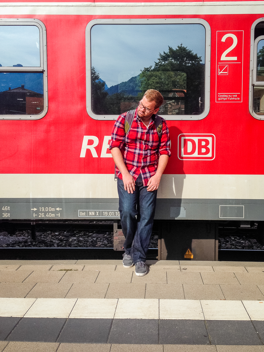"Me recreating an old photo in front of the Deuche Bahn train labeled ""Munich"", the source of so much confusion!!!"