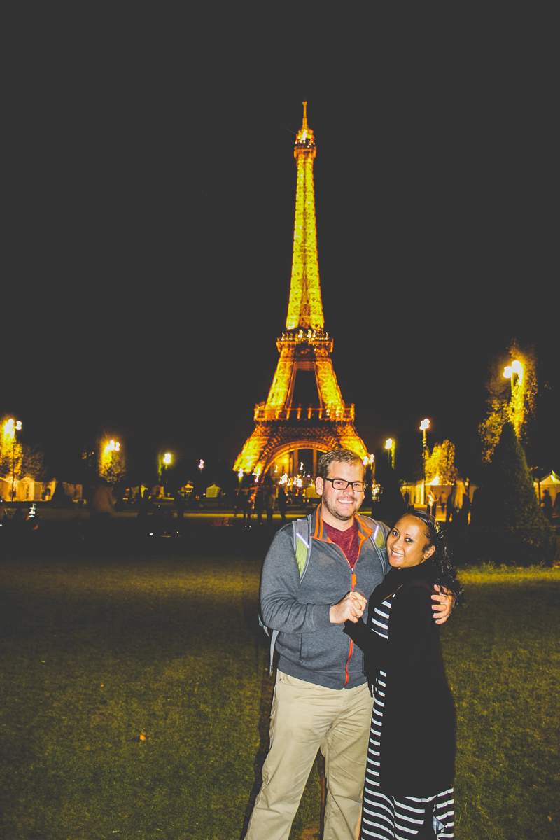 Posing with the Eiffel Tower and night, pre-engagement.
