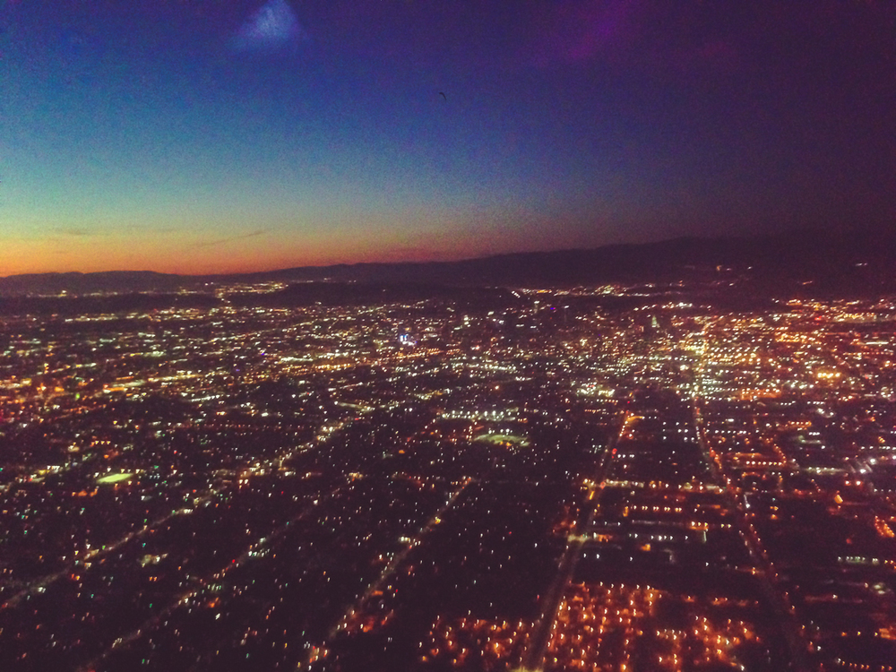 Preparing for a landing in Los Angeles with the last sunlight fading into the west.