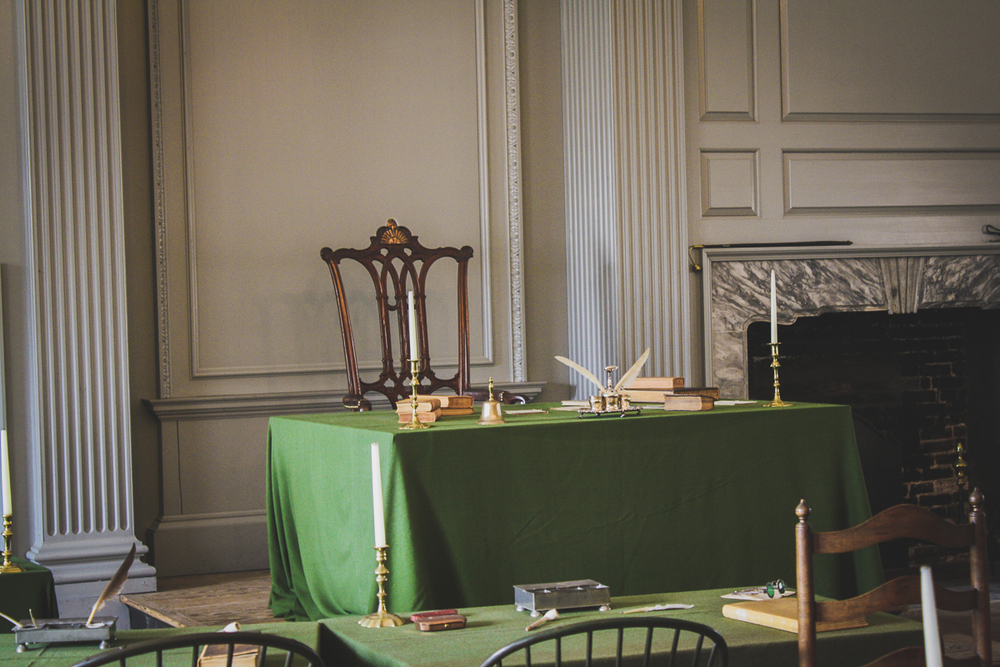 George Washington's chair. Do you choose to look at the sun on the chair as half-rising or half-setting?