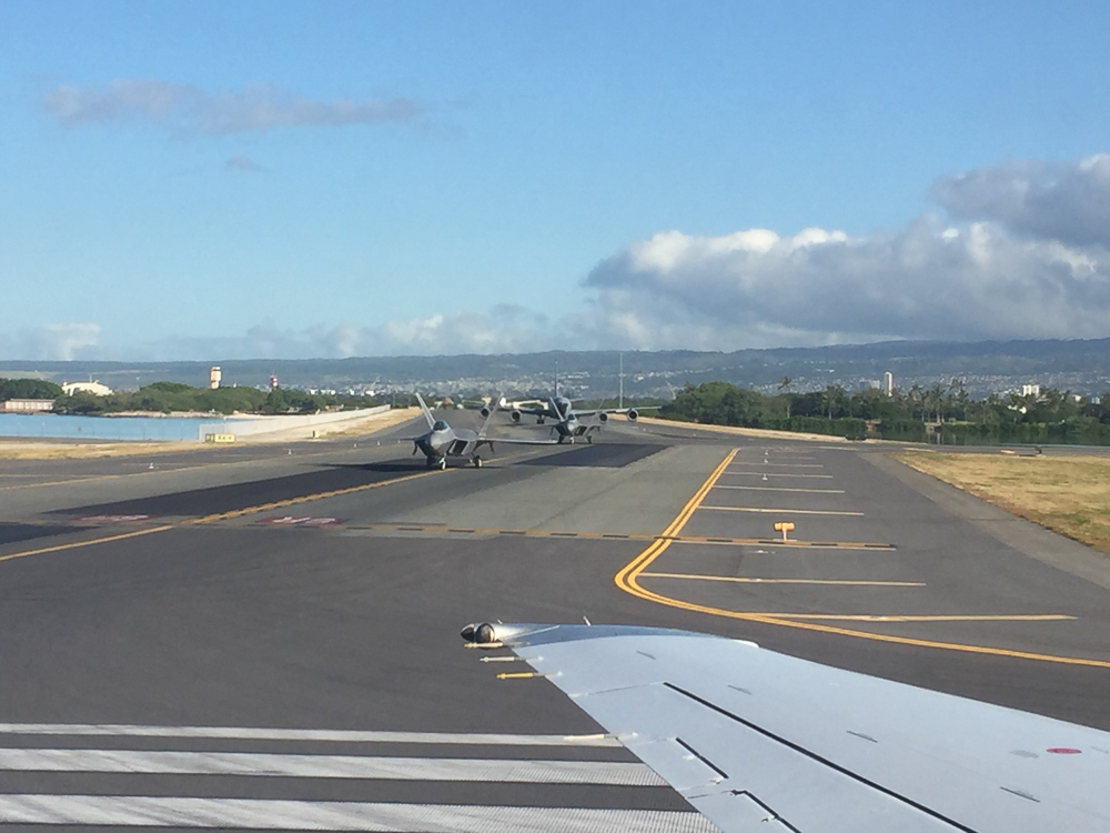 The Honolulu International Airport shares runways with the U.S. Air Force's  Hickam Field . I was glad I knew this or else I might have panicked to see us getting followed by fighter jets!