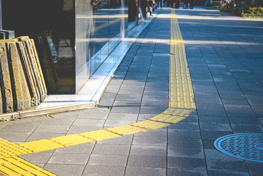 Sidewalks in Japan are extensively covered with tactile paving, designed to assist the blind as they move about.