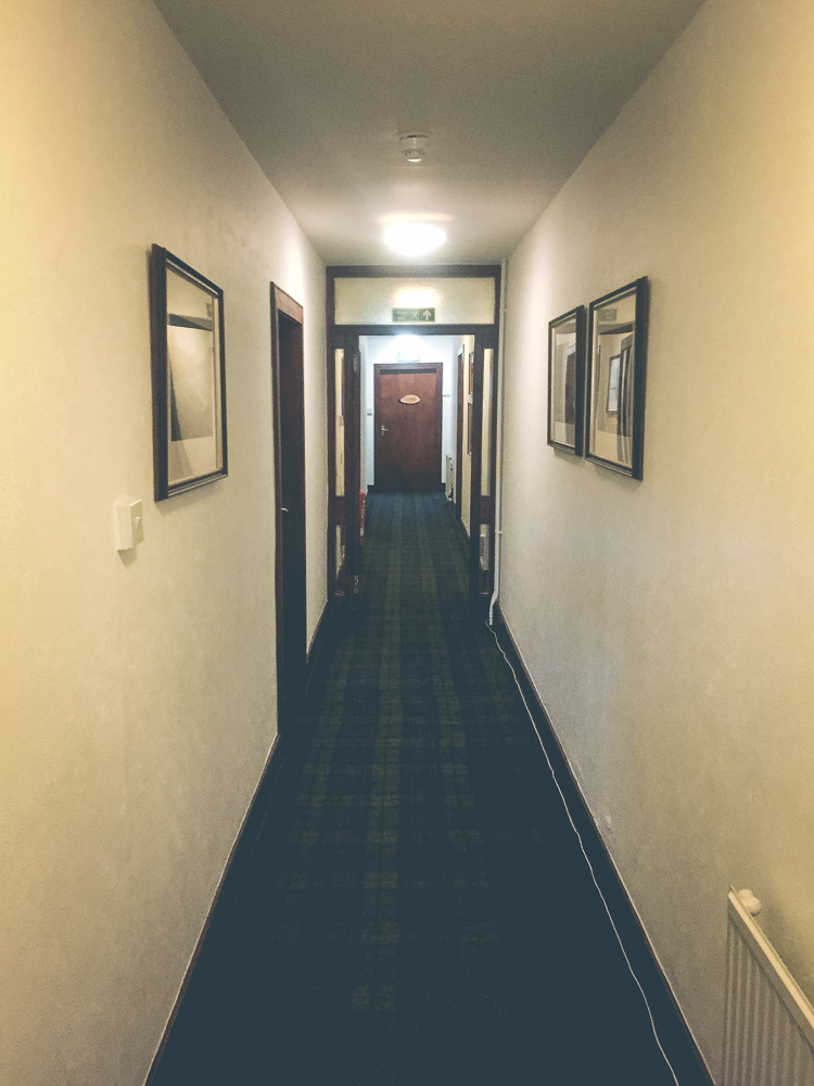 The slightly creepy hallway to our rooms at The Inch!