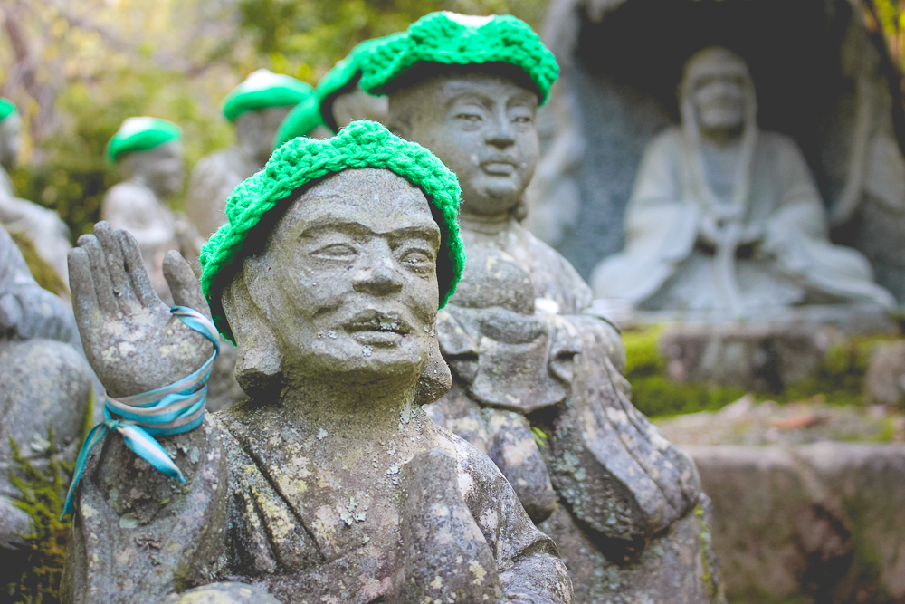Absolutely love the knit hats on these buddhas!